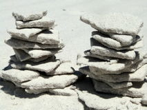 Two towers made of white sand on the beach Royalty Free Stock Images