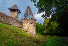 Two towers of Nevitsky castle. Cloudy autumn weather. some yellow foliage on the trees royalty free stock image