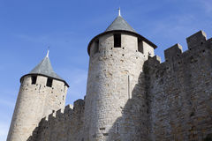 Two towers and their walls in Carcassonne city Royalty Free Stock Photography