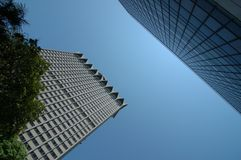 Two towers under the sun. Singtel tower and an other one on Orchard Road, Singapre royalty free stock image