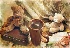Two toy bear-cub and cup Royalty Free Stock Images