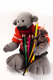 Two toy bear with a pencil Stock Image