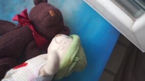 Two toy bears kissing on a windowsill