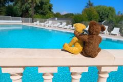 Two toy bears in love at swimming pool royalty free stock photos
