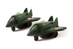 Two toy bomber planes, isolated on white background. Two toy green bomber planes, isolated on white background Royalty Free Stock Photos
