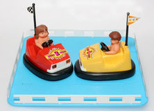 Two toy bump cars in cage. 2 plastic bump bump cars in a cage. One of the many thousand toys my brother is collecting. Battery opperated toy from the 80's Royalty Free Stock Images