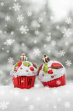 Two toy cakes on snow Stock Photography