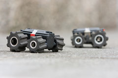 Two toy cars on a ground ready for a test-drive. Stock Photo