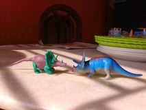 Two toy dinosaurs stock photography