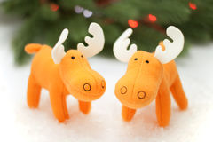 Two toy elks in artificial snow Royalty Free Stock Photography