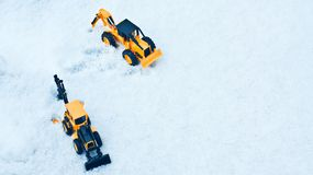 Two toy forklifts. White snow background. Seoul Winter Royalty Free Stock Photography