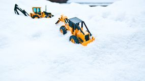 Two toy forklifts. White snow background. Seoul Winter Royalty Free Stock Image