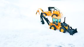 Two toy forklifts. White snow background. Seoul Winter Stock Images