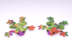 Two toy frogs. On isolated white Royalty Free Stock Image