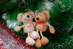 Two toy mouse sitting on the tree. Two funny toy mouse sitting on a Christmas tree arm in arm Stock Photos