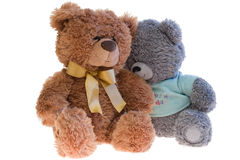 Two toy teddy bears together. Taken an over white. Isolated Stock Photos