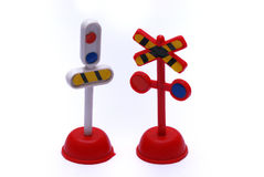 Two toy train signaling posts Royalty Free Stock Photo