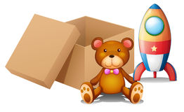 Two toys beside a box Royalty Free Stock Photo