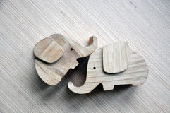 Two toys in the form of a stylized elephants. Two toys in the form of a stylized elephants on wooden background Royalty Free Stock Photography
