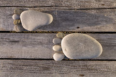 Two traces of pebbles over wooden planks Royalty Free Stock Photos