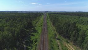 Two-track railway. The camera moves along the rail direction.  stock footage