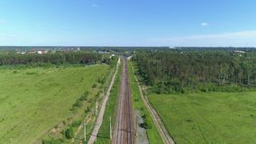 Two-track railway. The camera moves along the rail direction.  stock video