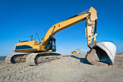 Two track-type excavator machines at earthmoving work Stock Images