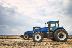 Two tractor cultivating the land Royalty Free Stock Images