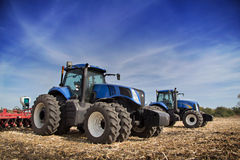 Two tractor drills in the field Stock Photos