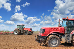 Two tractors on the field Stock Images
