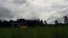 Two tractors lifts out forestry work stock footage