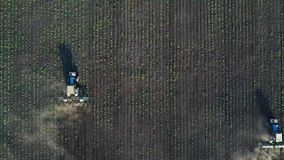 Two tractors performs seeding on the field stock footage