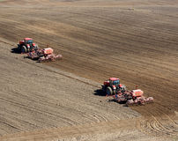 Two tractors sowing Royalty Free Stock Image