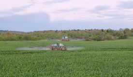 Two tractors spraying Royalty Free Stock Photo