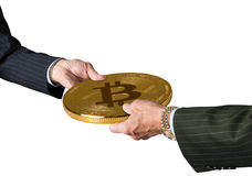 Two traders hands holding large bitcoin Royalty Free Stock Image