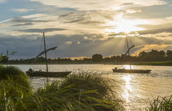 Two traditional Boats on the Loire with Sunset Royalty Free Stock Images