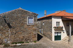 Two traditional colorful houses in the historic village of Castelo Mendo, in Portugal royalty free stock photo
