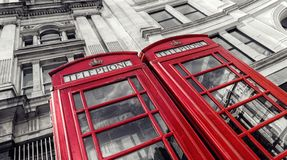 Two traditional red telephone booths in London city. Traditional red phone booths at london in black and white colors. ideal for websites and magazines layouts Royalty Free Stock Photos