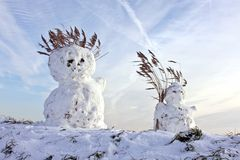 Two traditional snowmen in the Netherlands Royalty Free Stock Photos