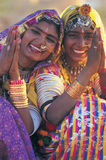 Two traditionally dressed women, India Stock Photos