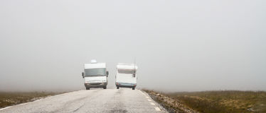 Two trailers. Two trailers on the road in fog. Norway Royalty Free Stock Photo