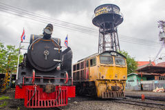 Two train cars at the maintenance center in Thailand. Royalty Free Stock Images