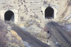 Two train tracks and two tunnels in Concept, Utah Stock Image