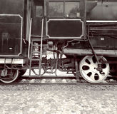 Two  train wheels  and locomotive driver's cab Stock Photo