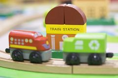 Two Train Wooden Toy with Train Station. In backdrop selective focused Play set Educational toys for preschool indoor playground Royalty Free Stock Photos