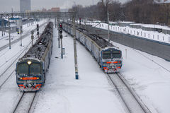 Two trains. Two passenger trains on the next ways in the winter Royalty Free Stock Photo
