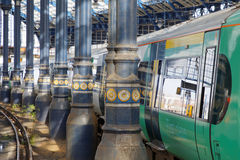 Two trains in the beautiful old train station in Brighton, UK Royalty Free Stock Photography
