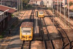 Free Two Trains In A Train Station Of Very Old Industrial Part Of The Town Zlin, Czech Republic Royalty Free Stock Images - 125473149