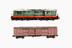 Two trains isolate on a white. Two trains - green and brown isolated on a white royalty free stock photo