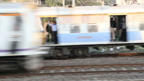 Two trains passing each other during departure in Mumbai. stock video footage